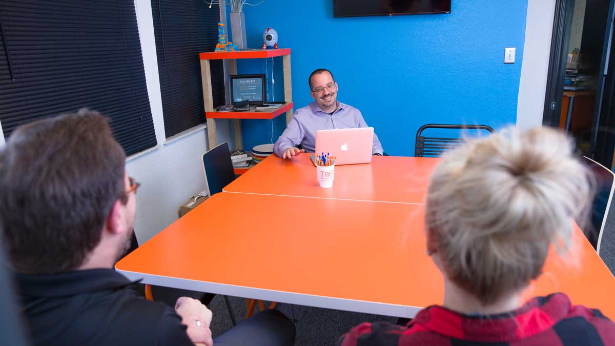 "Tim Priebe in meeting with two friends (Photo: <a href=""https://edmondbusiness.com/author/brent-fuchs/"">Brent Fuchs</a>)"