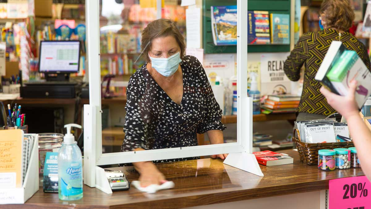"Nan Hight, co-owner of Best of Books helps customers on a busy Saturday morning (Photo: <a href=""https://edmondbusiness.com/author/brent-fuchs/"">Brent Fuchs</a>)"