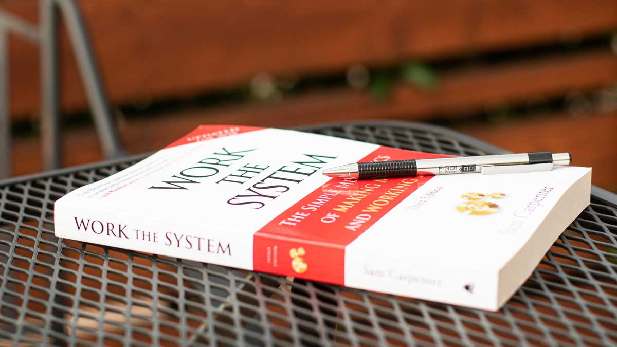 Work the System book on a table