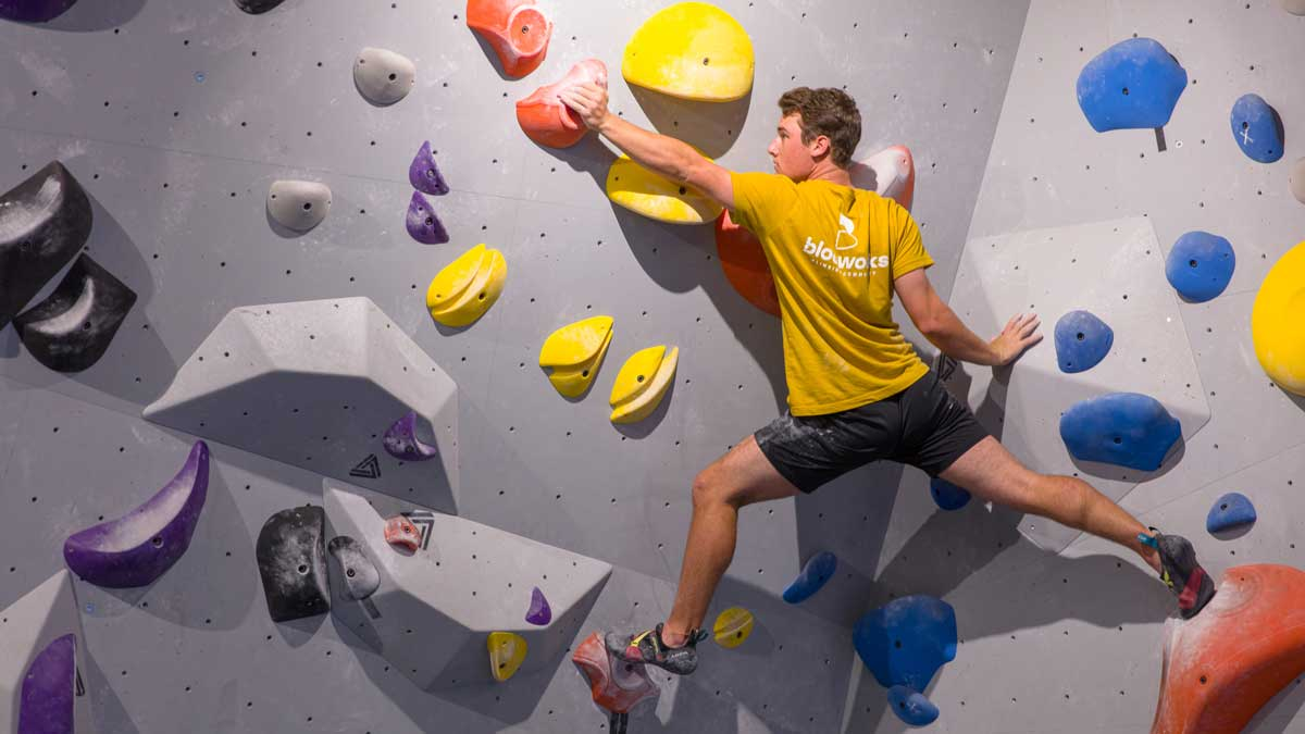 "Blocworks patron on climbing wall (Photo: <a href=""https://edmondbusiness.com/author/brent-fuchs/"">Brent Fuchs</a>)"