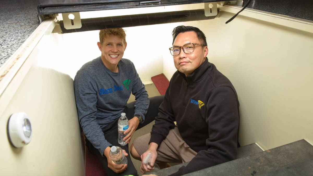 "Bryan Jackson and Hoang Lam, owners of Storm Check, in a shelter (Photo: <a href=""https://edmondbusiness.com/author/brent-fuchs/"">Brent Fuchs</a>)"