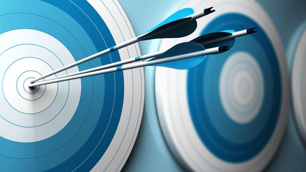 Darts in bullseye on target