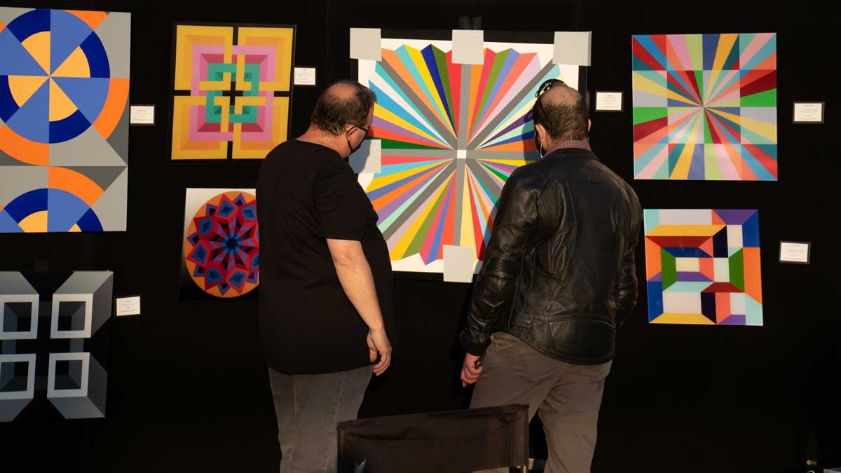 """VIBES attendees admire artwork at one of the many displays (Photo: <a href=""""https://edmondbusiness.com/author/brent-fuchs/"""">Brent Fuchs</a>)"""