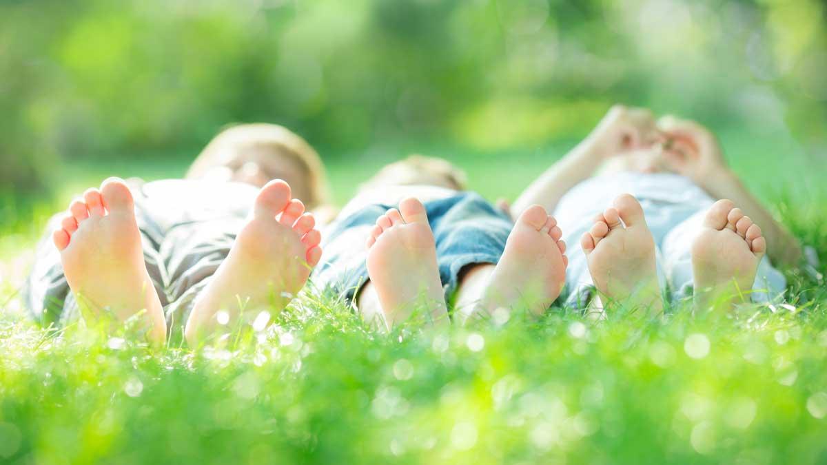 Three boys in grass