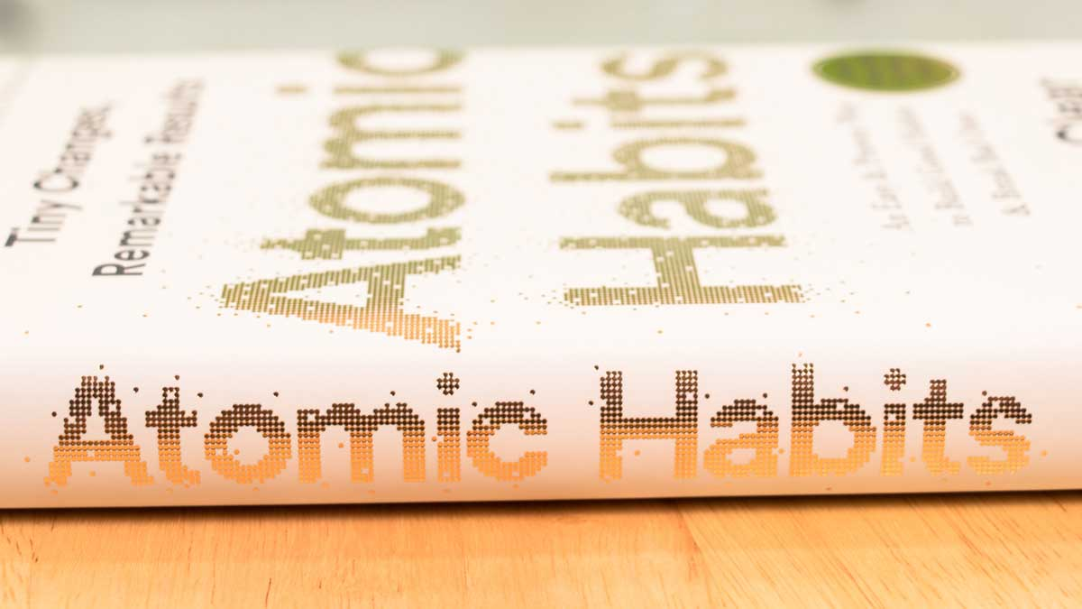 Atomic Habits book on table