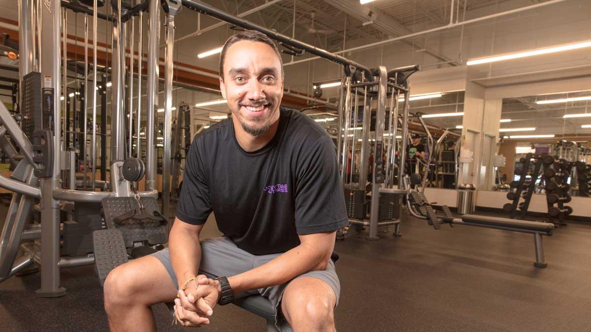"Jason Mack sits in Anytime Fitness in Edmond (Photo: <a href=""https://edmondbusiness.com/author/brent-fuchs/"">Brent Fuchs</a>)"