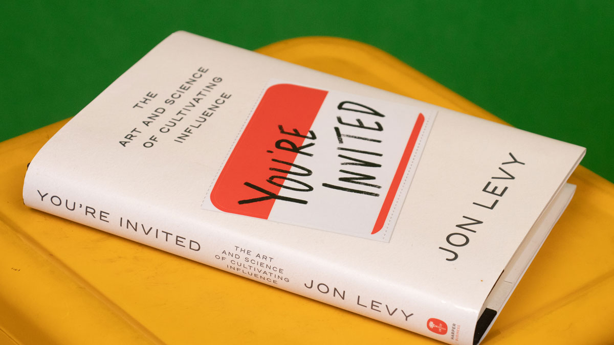 You're Invited book on yellow table